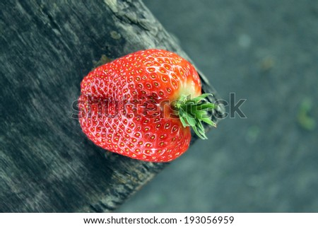 Strawberries. Strawberry on a wooden surface