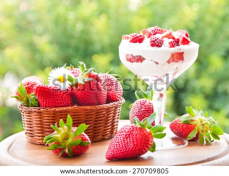 Strawberries with cream - stock photo