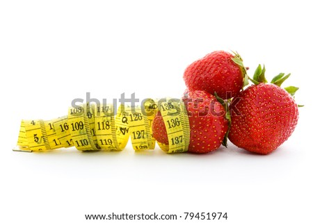 Strawberries with measure tape isolated on white.