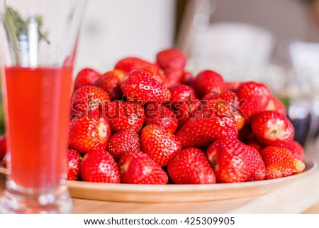 Strawberries without tails on the plate