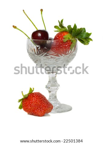 Strawberry and cherry in glass  on a white background