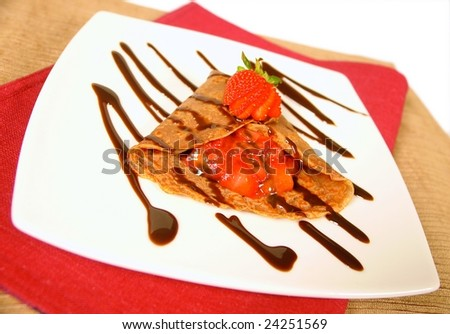 Strawberry and chocolate crepes - stock photo