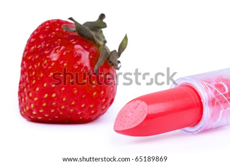 Strawberry and lipstick, closed-up on white - stock photo