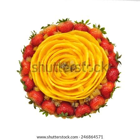 Strawberry and mango cake isolated on white - stock photo
