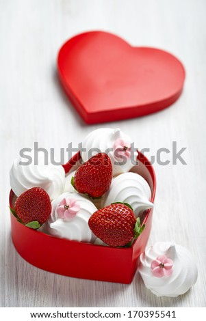 Strawberry and meringue for Valentine's Day in a heart shaped box - stock photo