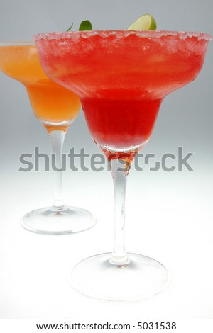 strawberry and orange margarita's on a graduated background