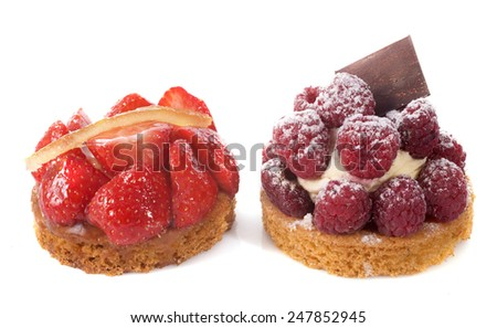strawberry and raspberry tart in front of white background