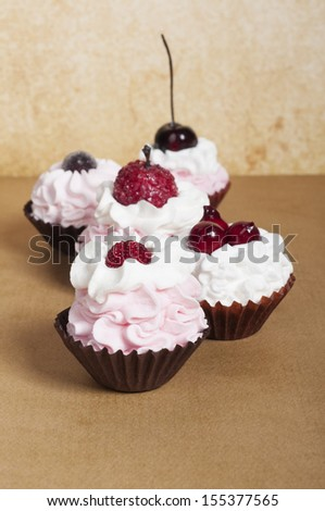 Strawberry baby cupcakes with fruit topping