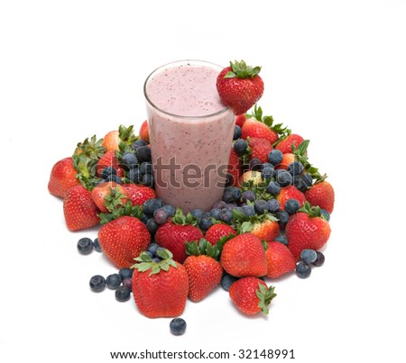 Strawberry Banana Blueberry Fruit  Smoothie in tall glass - strawberry garnish surrounded by fresh fruit against white.