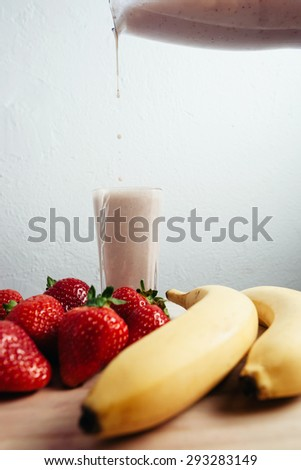 strawberry banana smoothie fresh blended on wood table