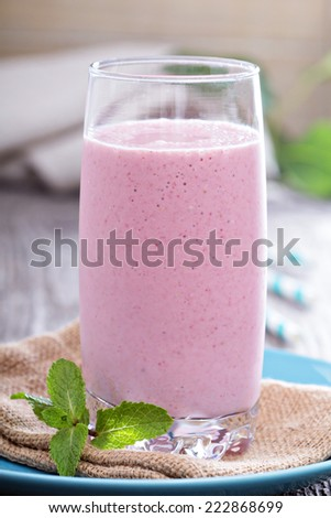 Strawberry Banana smoothie in a tall glass - stock photo