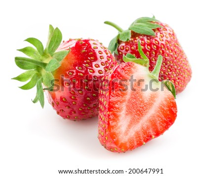 Strawberry. Berries with a half isolated on white - stock photo