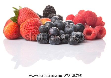 Strawberry, blackberry, blueberry and raspberry over white background - stock photo