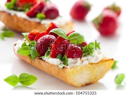 Strawberry bruschetta with goat cheese,basil and balsamic vinegar - stock photo