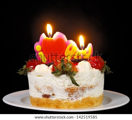 strawberry butter cream cake with heart candle on flashlight mix candlelight feeling