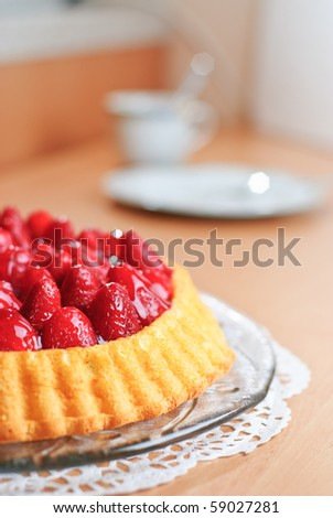 Strawberry cake on a kitchen table