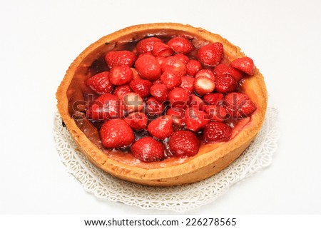 strawberry cake on a plate, isolated on white - stock photo