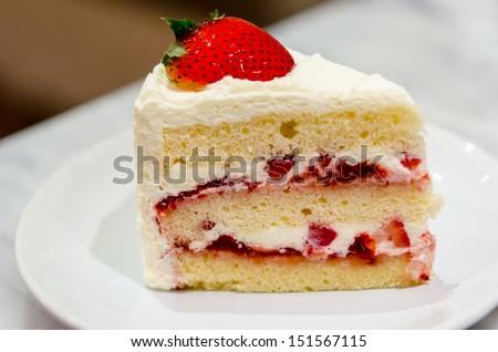 Strawberry cake on a white dish. - stock photo