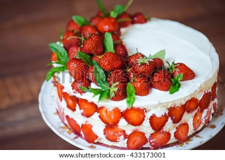 Strawberry cake on a wooden background. - stock photo