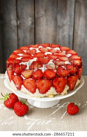 Strawberry cake on cake stand - stock photo
