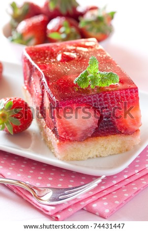 strawberry cake on plate with mint leaf - stock photo