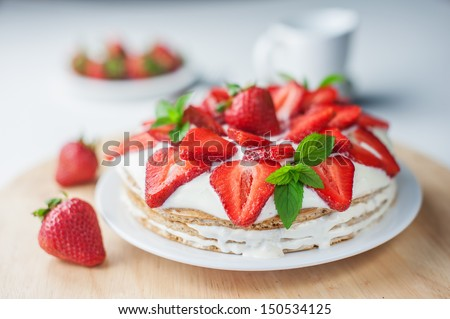 strawberry cake with mint twig - stock photo