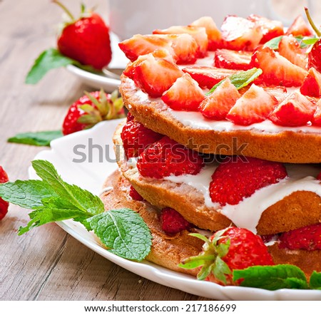 Strawberry cake with whipped cream in rustic style