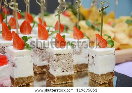 Strawberry cakes on tray closeup. Small shallow DOF. - stock photo
