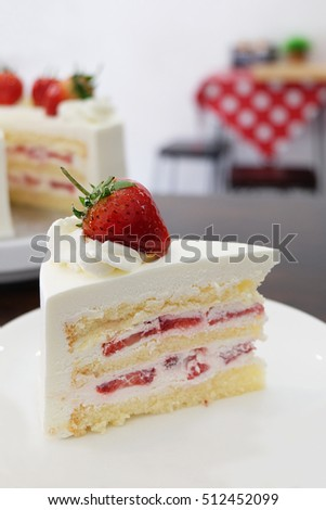 strawberry cakes with whipped cream on wooden table, white background and red polkadot