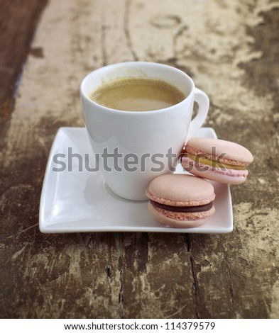 Strawberry & caramel macrons with cup of coffee - stock photo
