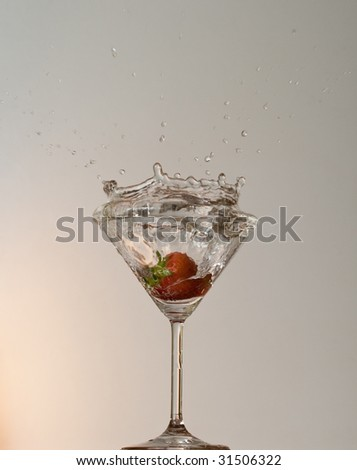 strawberry cast into the glass