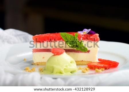 Strawberry cheese cake with mint ice cream - stock photo