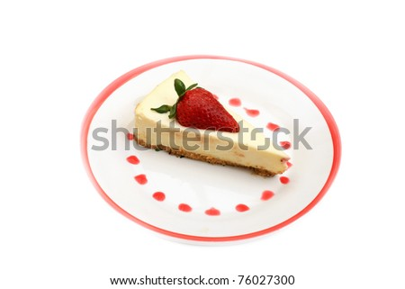 strawberry cheesecake on a white plate with a red rim and strawberry sauce dots in a circle - stock photo