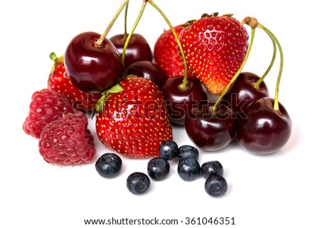 Strawberry, cherry, raspberry and blueberry isolated on white background - stock photo