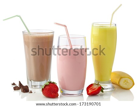 Strawberry, chocolate and banana milkshakes isolated on white background - stock photo