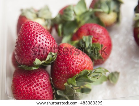strawberry close up in plastic container