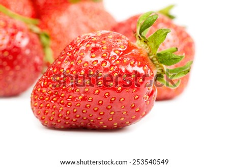 strawberry closeup on a background of ripe berries isolated - stock photo