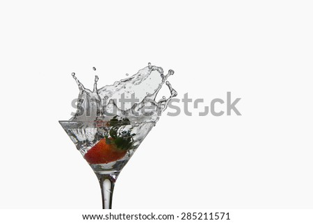strawberry cocktail drink with splash on white background - stock photo