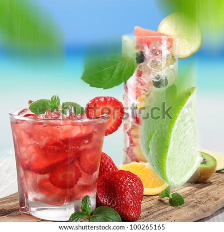 Strawberry cocktail on a beach - stock photo