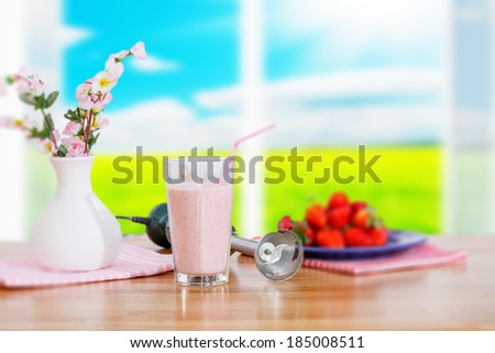 strawberry cocktail on the window background - stock photo