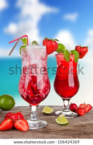 Strawberry cocktails with blur beach on background - stock photo