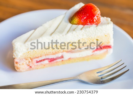 Strawberry cream cakes on white plate