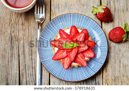 strawberry cream cheese tartlet  on a dark wood background. toning. selective Focus - stock photo