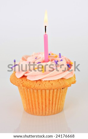 Strawberry cupcake with candle.