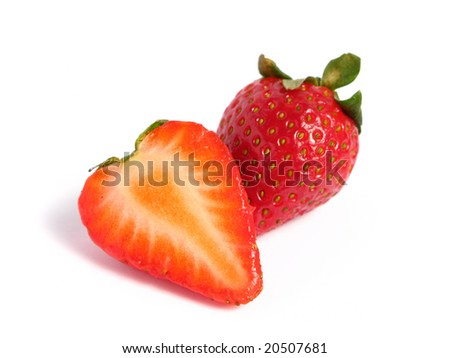 Strawberry cut in half on white background - stock photo