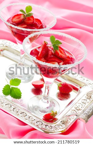 Strawberry dessert in a pink wine. - stock photo