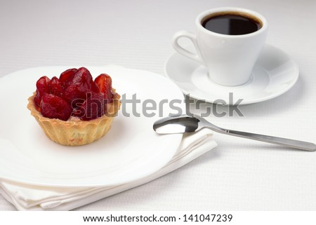 Strawberry Dessert in a Waffle Basket with Cup of Black Coffee