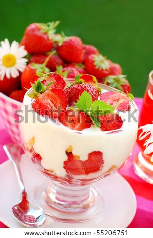 strawberry dessert with fresh fruits,crumble and whipped cream - stock photo