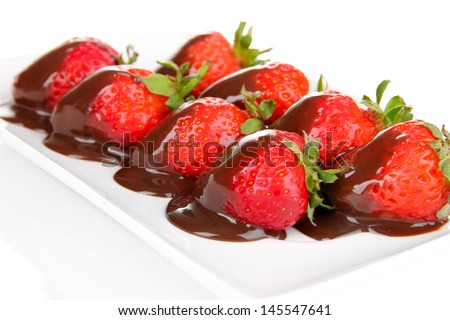 Strawberry dipped in chocolate fondue isolated on white - stock photo