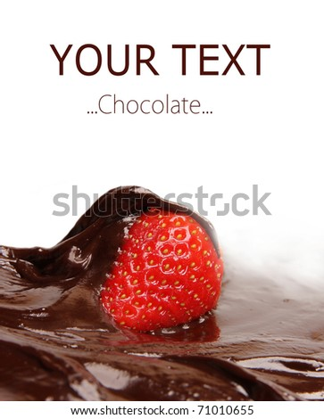 Strawberry dipped in melting dark chocolate - stock photo